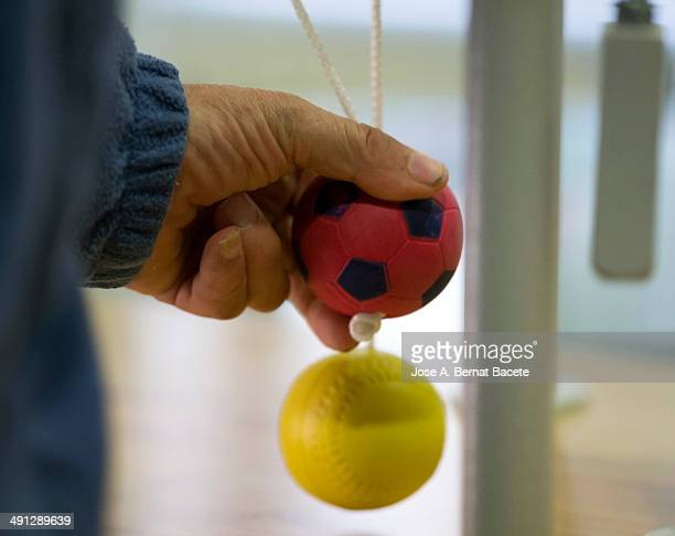 Hand of a man pushing hard in rehab