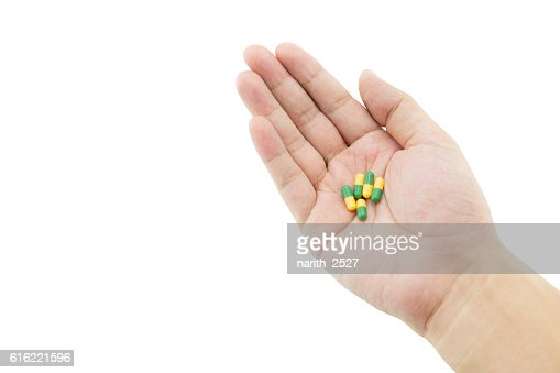 hand of a man with some capsule pills : Stock Photo