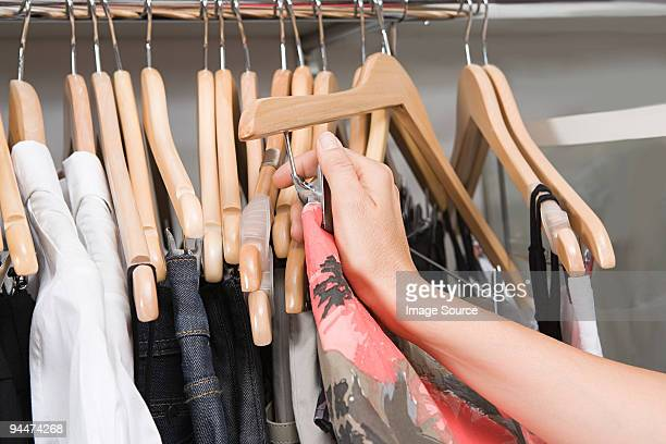 Hand of a woman and clothing rail