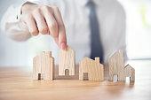 Hand of businessman choosing house model, Planning buy Real Estate
