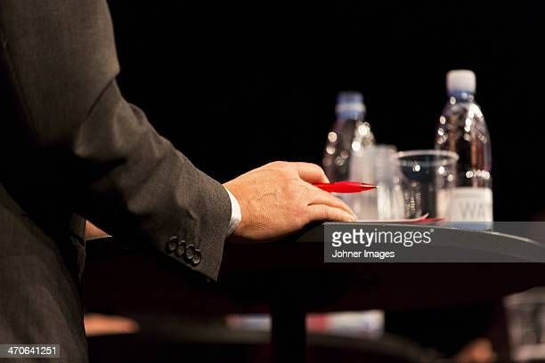 Hand of businessman sitting at meeting