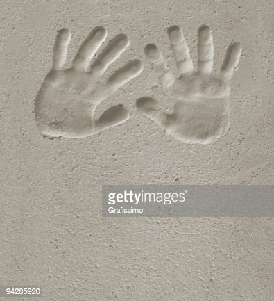 Hand of child prints on cement