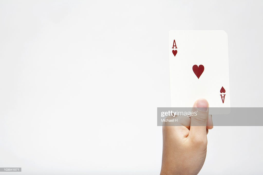 Hand of child who has ace of heart : Stock Photo
