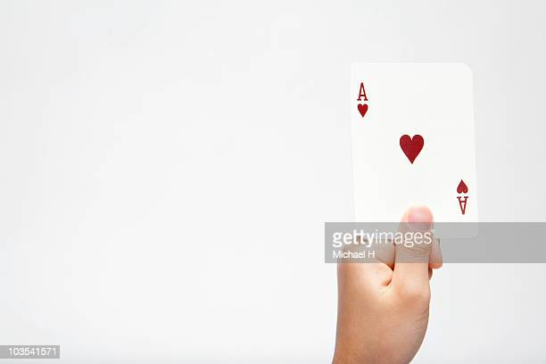 Hand of child who has ace of heart