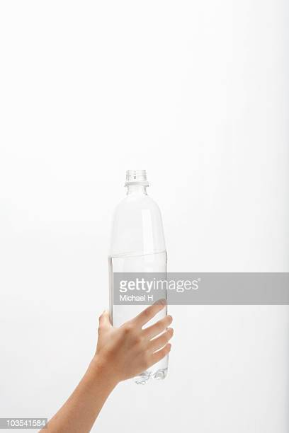 Hand of child who has PET bottle