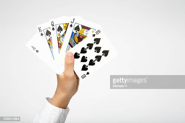 Hand of child who has royal straight flush