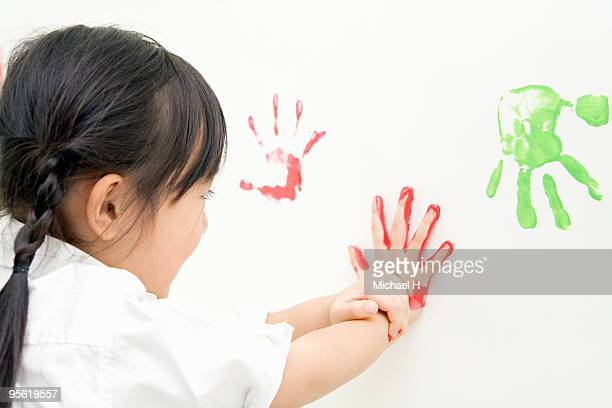 Hand of child who takes bill with paint