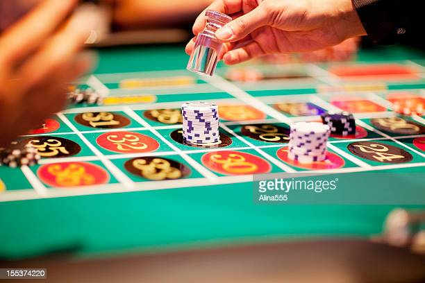 Hand of dealer declaring a winner at the roulette table