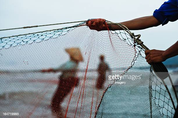 Hand of fishermen holding fish net,Central Vietnam