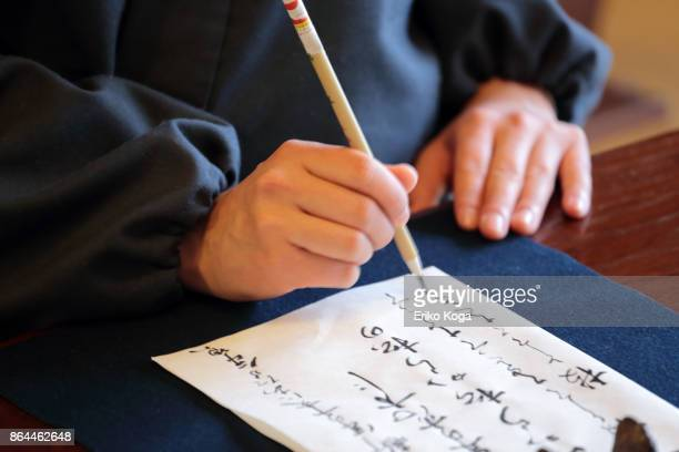 Hand of man doing calligraphy