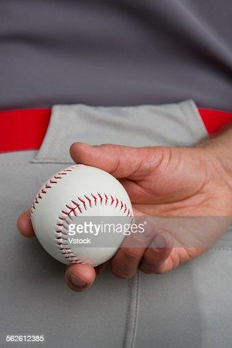 Hand of man holding baseball