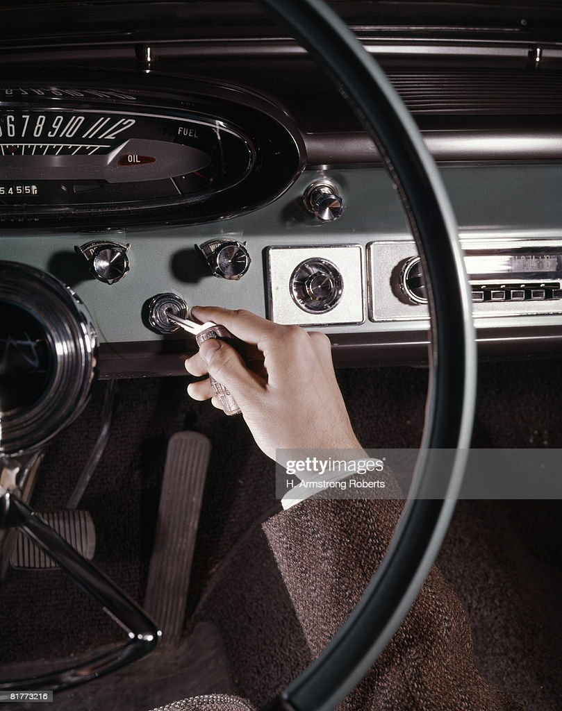 Hand Of Man Inserting Key Into Automobile Ignition Close-Up Detail Interior Car. : Stock Photo