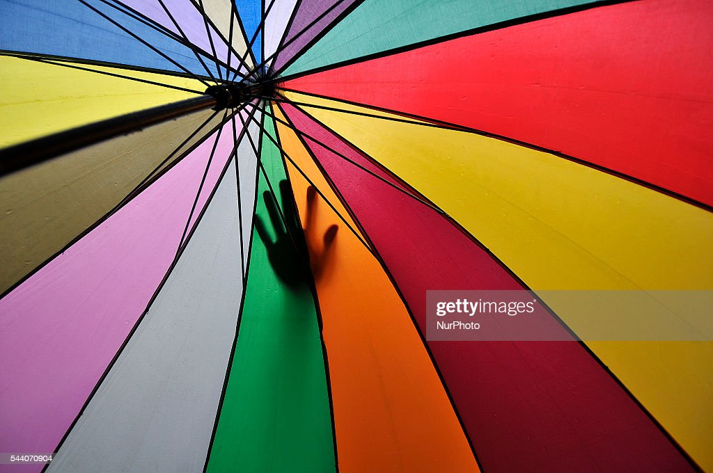 A hand of Nepalese Muslim seen on his friend's umbrella as came to offer Ritual Prayer on Last Friday of Ramadan on a monsoon rain at Kashmari Jame mosque at Kathmandu on July 1, 2016. Ramadan (also known as Ramadhan or Ramzan) is the ninth month in the Islamic calendar. During the month of Ramadan; Muslims fast from dawn to dusk all over the world. While fasting from dawn until sunset; Muslims avoid from consuming food; drinking liquids; smoking; and engaging in sexual relations.