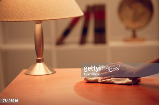 Hand of person dusting table