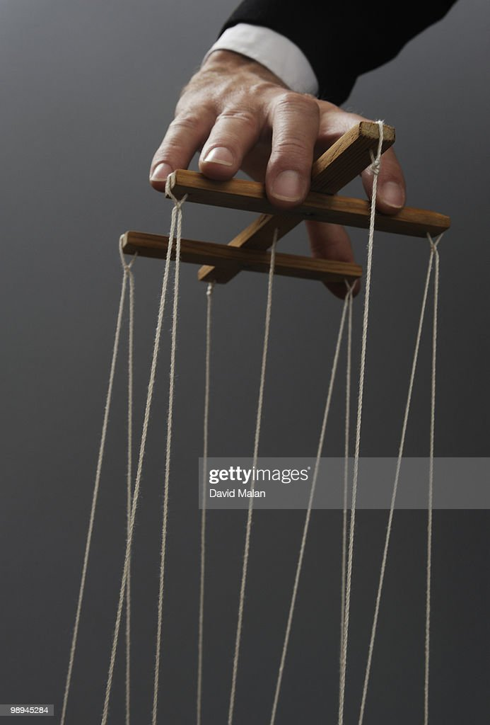 Hand of puppeteer : Stock Photo