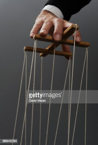Hand of puppeteer