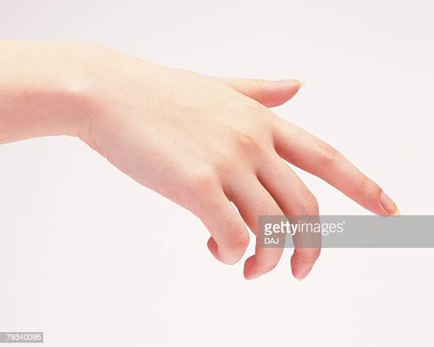 Hand of woman pointing down