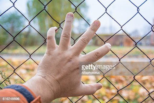 hand on a fence, there is no way, Chernobyl : Stock Photo