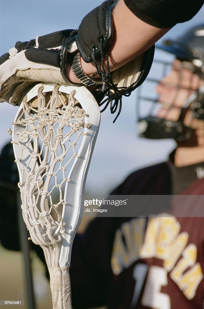 Hand on a Lacrosse Stick