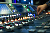 Hand on a Mixing Desk Fader in Television Gallery