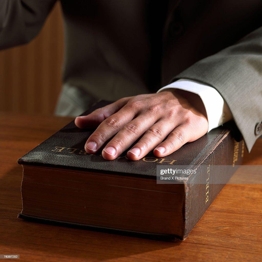 Hand on bible, swearing in : Stock Photo