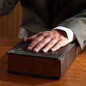 Hand on bible, swearing in