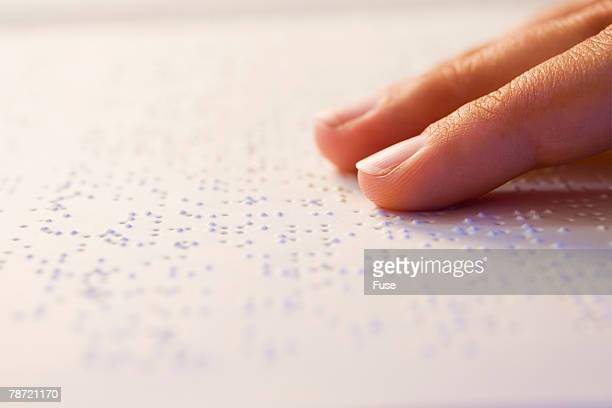 Hand on Braille Page