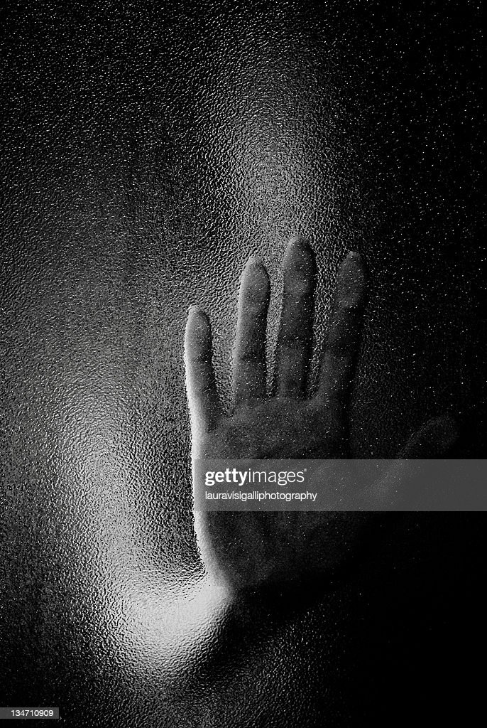 Hand on glass : Stock Photo