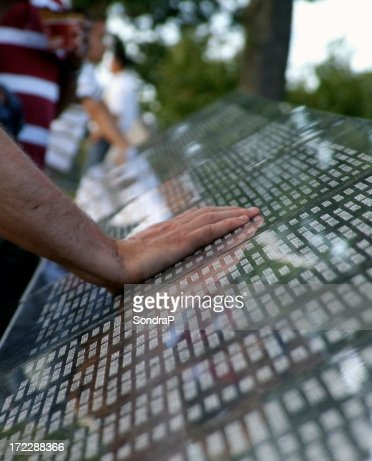 Hand on Memorial Wall