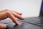Hand working over a touchpad