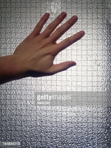 Hand on safety glass : Stock Photo