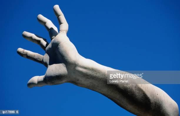 Hand on statue on Fontana dei Quattro Fiumi by Bernini, Piazza Navona, Rome, Italy