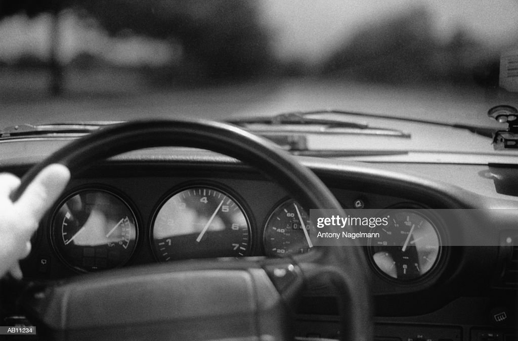 Hand on steering wheel of car (B&W) : Stock Photo