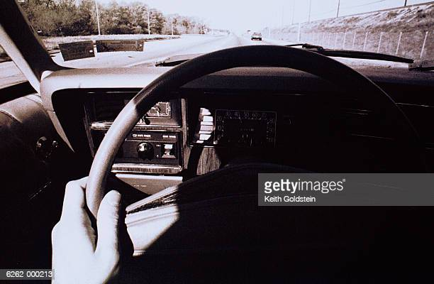 Hand on Steering Wheel