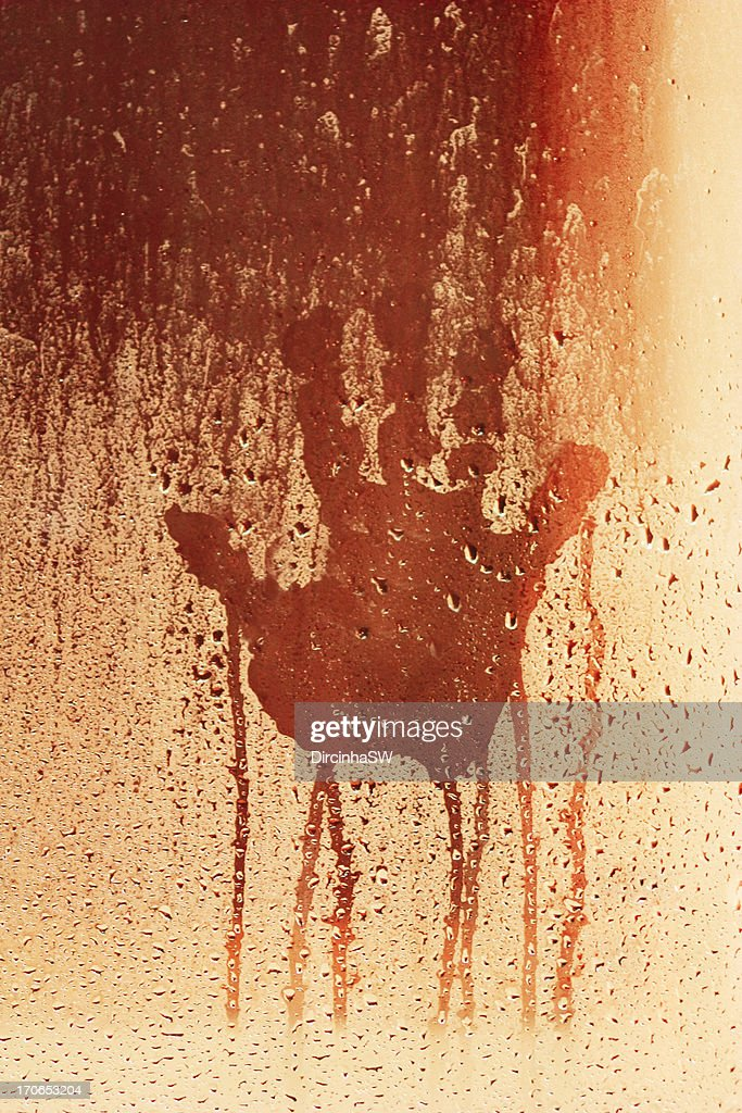 Hand on wet glass. : Stock Photo