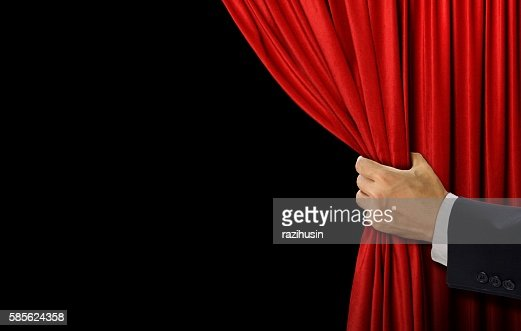 Hand open stage red curtain on black background : Stock Photo