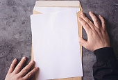 Hand opening brown Document Envelope with copy space