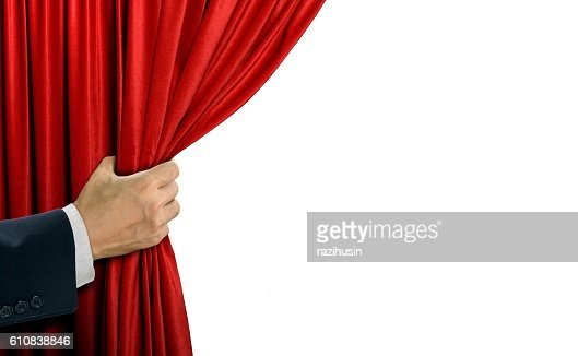 Hand opening stage red curtain over white : Stock Photo