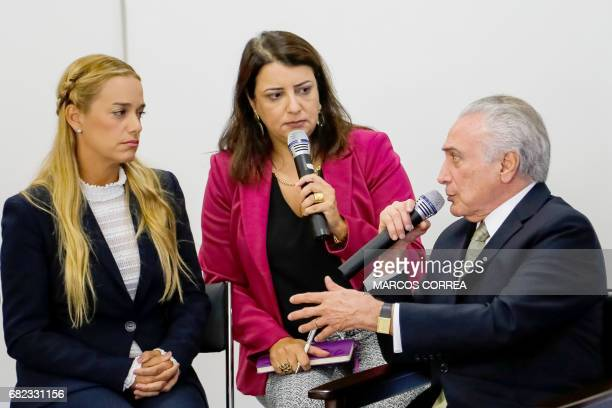 Hand out picture released by Brazilian Presidency showing Brazil's President Michel Temer and Lilian Tintori wife of jailed Venezuelan opposition...