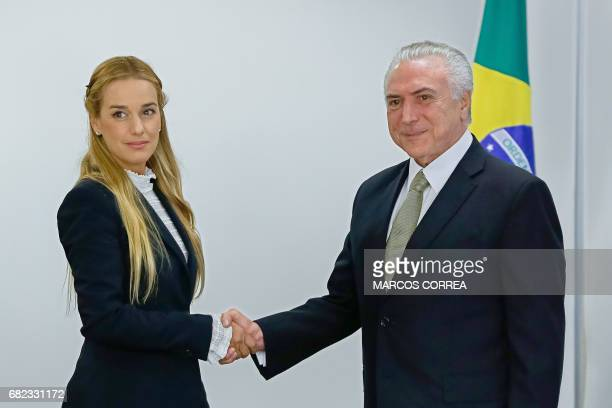 Hand out picture released by Brazilian Presidency showing Brazil's President Michel Temer shaking hands with Lilian Tintori wife of jailed Venezuelan...