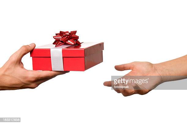 Hand outstretched to receive red and white wrapped gift