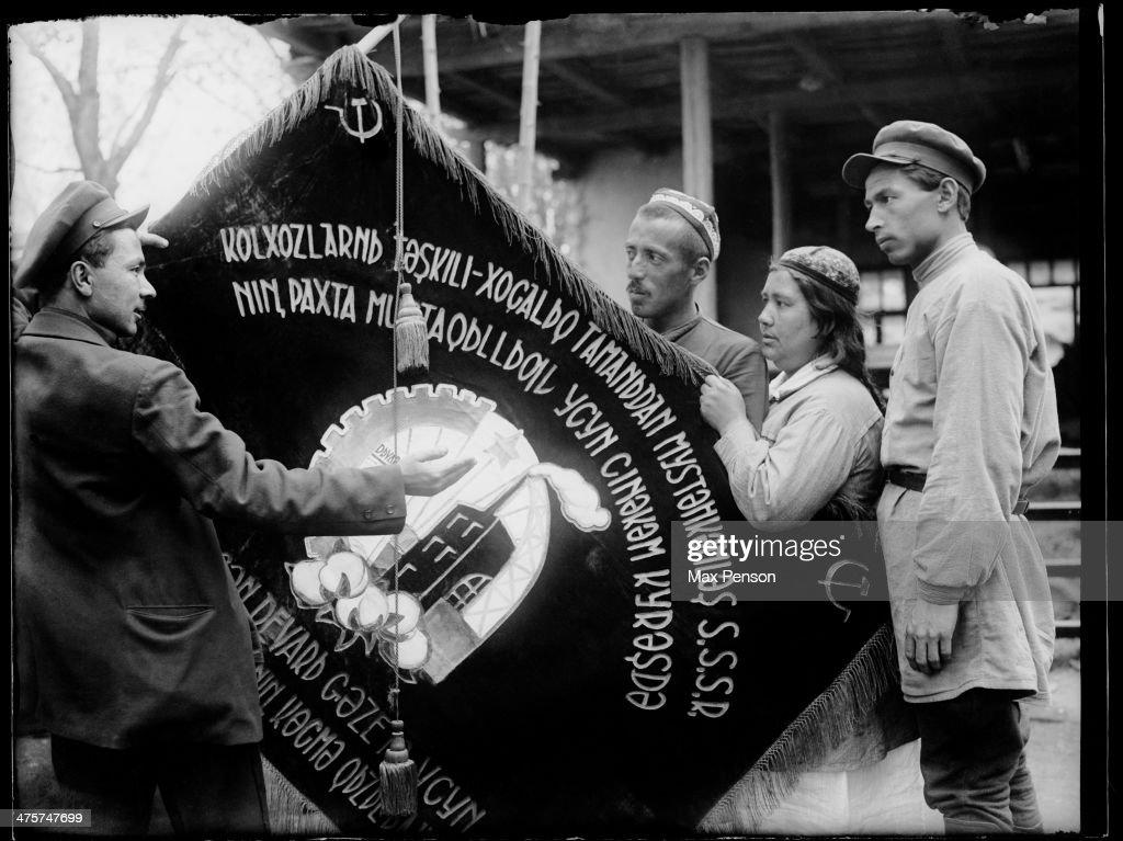 Hand over a passing collective-farm banner, circa 1940.