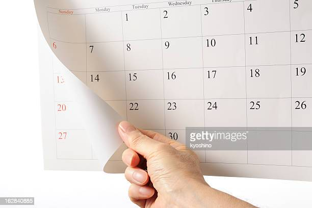 ハンド overturns カレンダーシートの背景に白色