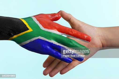 Hand painted flag of South Africa doing handshake