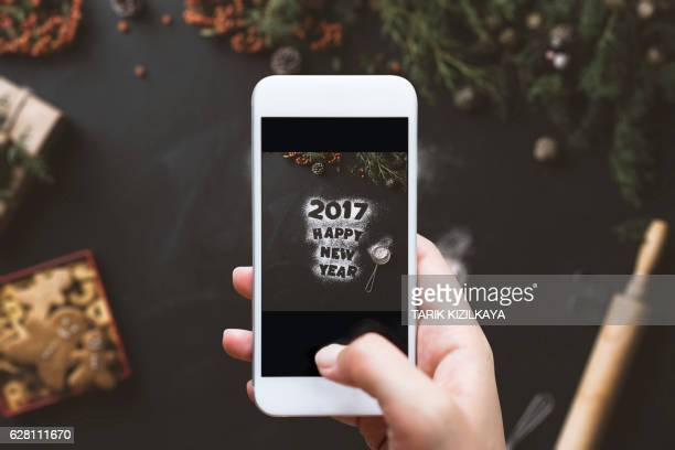 Hand photographing, Happy New year 2017 concept table top