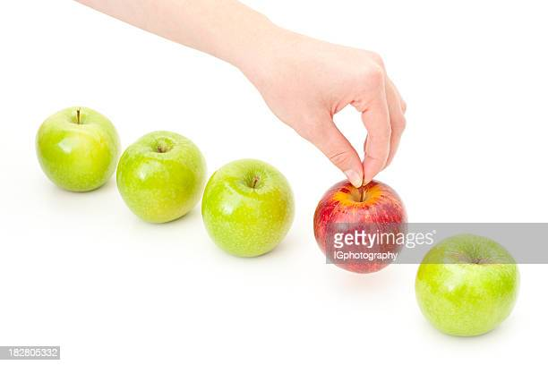 Hand Picking Apple from Row to Illustrate Choice and Decision