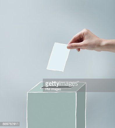 Hand placing ballot : Stock Photo
