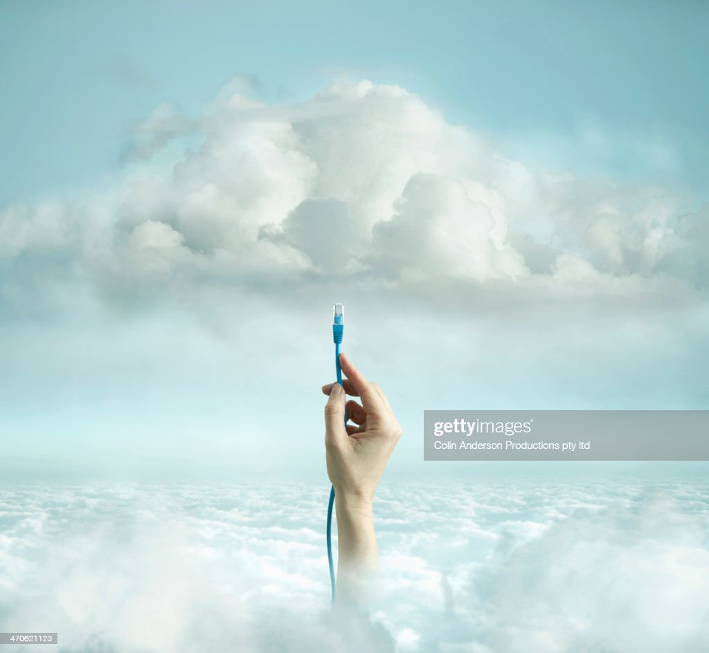 Hand plugging wire into cloud