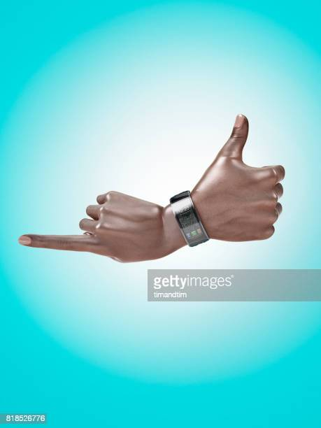 Hand pointing and hand with thumb up