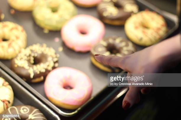 Hand Pointing At Donuts